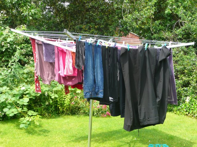 washing hanging out on the line, complete with pegs!