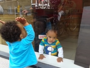 Michael & Leon playing in the window