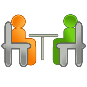 Green and orange figures sitting at a desk (from openclipart)