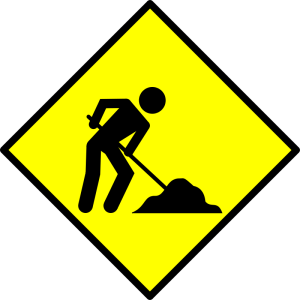 Black man on yellow background shovelling