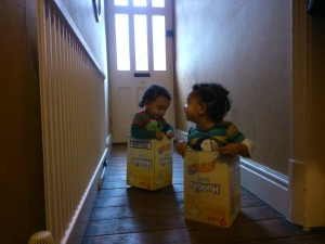 My sons in Huggies boxes